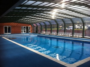 Swimming pool dehumidification